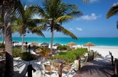 Seaside eating at a restaurant on Grace Bay Beach in Turks and Caicos Islands - Karen Wunderman/Getty Images
