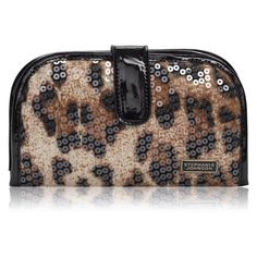 """Stephanie Johnson Jewelry Case The Julie Jewelry Case is a wonderful pouch Keep your jewels organized with this chic case. The outside of the case is a real head-turner, with animal print and sequins and a black patent leather snap closure. The inside flaunts three zipper compartments and a ring roll for easy organization.  Measurements: Length: 7 1/4"""" Height: 9""""  (when folded out) stephanie johnson Accessories"""