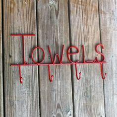 "Red Bath ""Towel"" Hook/ Bath, Beach Towel, Robe Hanger/ Shabby chic/ Bathroom Fixture/ Beach House, Pool Acessory. $26.99, via Etsy."