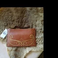 Michael Kors large zip clutch New with tags, Michael Kors Rhea large zip clutch, studded lamb leather. The leather is soft and silky. Very luxurious clutch for a fraction of the original price. Michael Kors Bags Clutches & Wristlets
