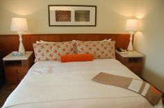 The Mauna Kea Beach Hotel kept its signature orange-and-white palette, but added a mod-Asian flair to its room decor.