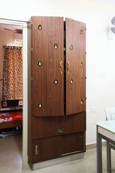 Discover some small pooja cabinet designs; you can place them anywhere in the house. Go for a standalone or a custom built-in pooja cabinet. Pooja Room Design, Room Design, Bedroom Cupboard Designs, Room Interior, Room Door Design, Cupboard Design, Pooja Room Door Design, Living Room Tv Unit Designs, Living Room Designs