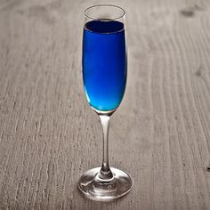Diamond Blue cocktail recipe -       .75 oz Hendrick's Gin      .75 oz Crème de violette      .25 oz Blue Curaçao      1 Lemon wedge      3 oz Champagne  click for the rest
