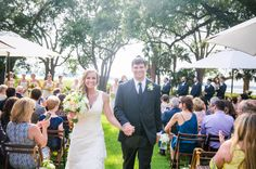 Walking down the aisle at Lowndes Grove Plantation House | Charleston, SC | Outdoor ceremony | Photo by Dana Cubbage