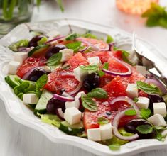 An absolutely delicious watermelon feta salad recipe. Watermelon is with no doubt the fruit of the summer and this refreshing combination of juicy, chilled slices of watermelon and salty, creamy feta cheese make for a Greek salad summer favourite! Watermelon Feta Salad Recipes, Watermelon And Feta, Greek Salad Recipes, Summer Salad Recipes, Summer Salads, Cucumber Salad, Summer Food, Greek Salad Recipe Authentic, Feta Cheese Recipes