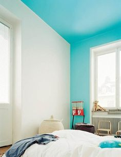 You may have heard of painting the ceiling, but here, painting the ceiling and a single wall elevates the walls and ceiling into floating panes of color. Hus  Hem via Plenty of Colour.