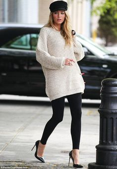 Cute and cosy: Blake's most casual look saw her in a baggy cream knit jumper with black leggings, court shoes and baker boy cap
