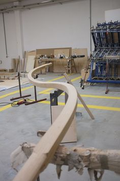 #stairstalk - the first of many luscious curves being painstakingly crafted  at the #trabczynski workshop with @atmosstudio @lustedgreen @thesewhitewallsstudio   many layers of oak veneer were bent and glued together, and were then carved by hand and machine into the various elements  #woodcraft #LVL #laminatedveneerlumber #oak #grandesignstaircases #theworldneedsmorespiralstaircases #woodart #woodconstruction #workmanship #craft #artisans #poland #atmos