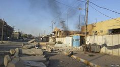 A damaged police station is seen in the Anbar province town of Hit on 6 October 2014