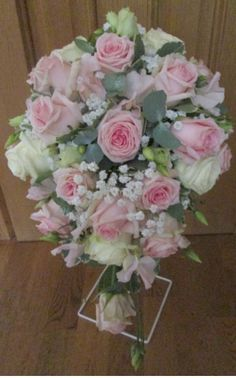 Cascade bouquet of pink roses with gypsophila, lisianthus and eucalyptus