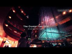 """TeamLab staged their """"Crystal Tree"""" at the Canal City mall in Fukuoka. Hundreds of suspended LED lights created a mesmerizing and sparkling Christmas tree. What's more, visitors could decorate the tree themselves using their smartphones."""