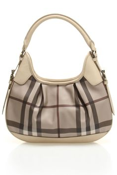I try to act all crunchy but I secretly adore Burberry bags.