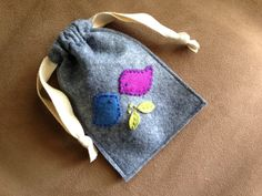 Knack and Whimsy: C r a f t B r e a k : F e l t B a g                                                This little bag makes a great gift or works as the perfect holder for a special piece of jewelry or other little trinkets.