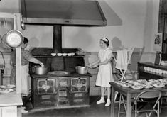 """May 1943. """"Keysville, Virginia. Randolph Henry High School. Kitchen of cafeteria. Lunches cost about 15 cents."""