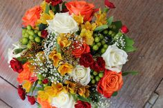 Fall wedding Bouquet: Orange and White Roses, Yellow Alstromeria, green hypericum, and Mini carnations