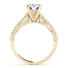 Two rows of gorgeous diamonds lined with a stunning vintage style milgrain border. The design on the sides of the ring add a special touch as a stunning Forever One center stone is displayed front and