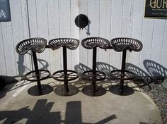 Vintage tractor seat stools... I have a neighbor who welds... I bet he could do this for me for a good price :]