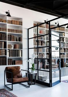 LOVE the black glass false wall for loft