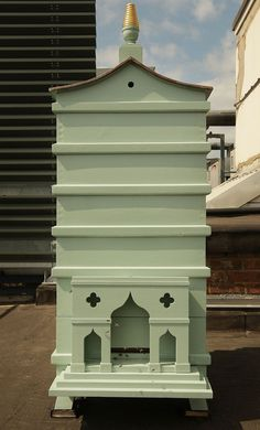 A newly installed behive sits on the roof at Fortnum and Mason on July 22, 2008 in London. LOVE this pretty hive!