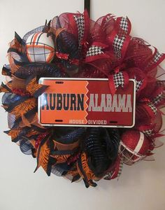 This is a Auburn/Alabama House Divided Deco Mesh Wreath - handmade. 24 in x 24 in and can be hung on a wreath hanger. I have started Wreaths For Sale, Holiday Wreaths, Thanksgiving Wreaths, Auburn Wreath, Auburn Alabama, Alabama Football, House Divided Wreath, Alabama Wreaths, Sports Wreaths