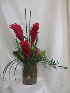 Red Hot Ginger Tropical Bouquet by Enchanted Florist Pasadena TX. Lovely tropical red ginger in a clear oblong vase with greenery accents. Tropical Flower Arrangements, Artificial Floral Arrangements, Tropical Flowers, Tropical Centerpieces, Table Centerpieces, Fresh Flowers, Colorful Flowers, Spring Flowers, Unusual Flowers
