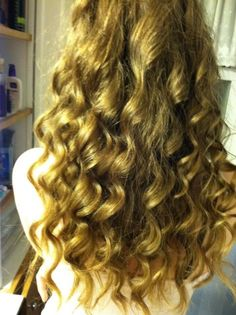 hold curling iron upside down and wrap the hair around the entire barrel. spray with hair spray.