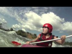 Funny scared girl running grade 5 rapid Itanda falls in a tandem kayak