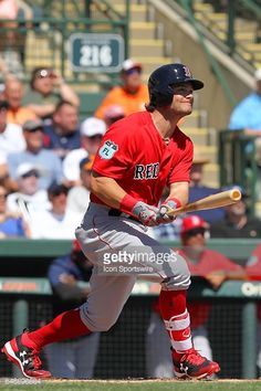 News Photo : Andrew Benintendi of the Red Sox watches his...
