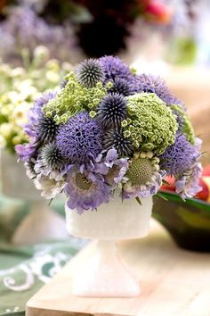delicate purple & green arrangement.  It includes echinops, allium, scabiosa, and queen anne's lace