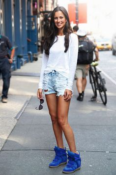 shorts with blue UPERE wedges