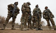 German Bundeswehr army soldiers with the Delta platoon of the 2nd paratroop company 373 listen to a briefing before they leave a combat outpost for a mission in the city of Iman Sahib, north of Kunduz, northern Afghanistan, December 6, 2010.