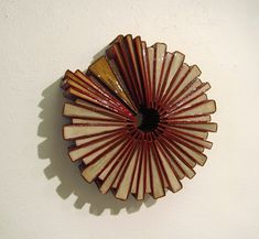 Repurposed Book Art - love the idea of adding a clearcoat to the finished designs!!