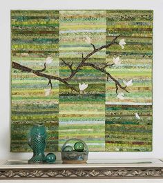 The Magnolia Blossoms Quilt Pattern takes an artistic approach using a simple strip pieced background. This is an easy quilt to put together with the appli