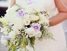 Wedding Flowers: Gorgeous cascading bridal bouquet with white tulips, white roses, white stephanotis, and lavender roses.