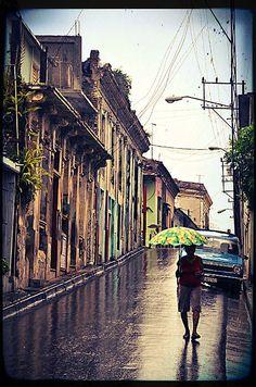 Street of Santiago de Cuba during the rainy day.