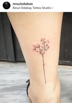 Tiny flower tattoo