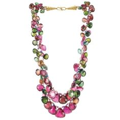 Double Strand Gem-Set Bead Fringe Necklace with Gold Clasp The double strand graduated necklace set continuously with a fringe of rubellite, tourmaline and pink tourmaline briolettes, spaced by small faceted multicolored sapphire beads, completed by a gold hook clasp joined by two polished and rope-twist gold cones, one loose tourmaline briolette. Length 16 inches.