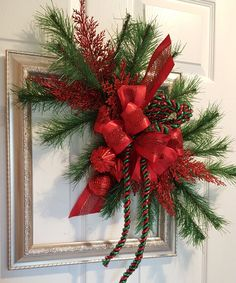 Decorated picture frame wreath for a garden club fundraiser. Good luck to my friends. Picture Frame Wreath, Picture Frames, Holiday Wreaths, Holiday Decor, Garden Club, Frame Crafts, Fundraising, Friends, Outdoor Decor