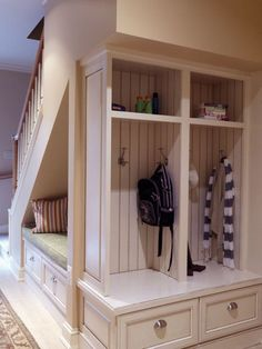 Mudroom locker storage under the staircase.