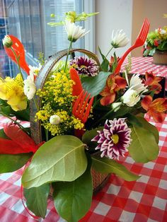 Going on a picnic? A fun idea for a floral centerpiece. Mixed floral arrangement, picnic themed flowers.