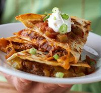 A Mexican Patio Party Barbecue: Quesadillas  ingredients: Nonstick cooking spray,   4 [7- or 8-inch] flour tortillas,   1 cup shredded extra-sharp cheddar cheese or Mexican cheese blend (4 ounces)  1 [4-ounce] can diced green chiles, drained,   1 [18-ounce] tub refrigerated barbecue sauce with shredded chicken (2 cups)  1 cup bottled salsa,    1/4 cup dairy sour cream,   1/4 cup sliced green onion (2) Directions:   1. Coat one side of each tortilla with cooking spray. Place, coated sides down...