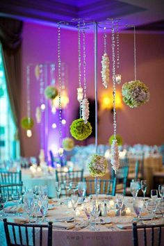 I like this idea of hanging center pieces that way the center piece doesn't block people's faces.