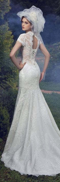 Milva 2016 Wedding Dresses. The veil is definitely not my style, but this dress is amazing.