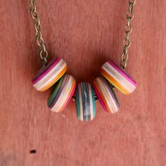 Wooden bead necklace made using broken skateboards. Amazing colours and beautiful finish. Hand crafted by Sam Messina.