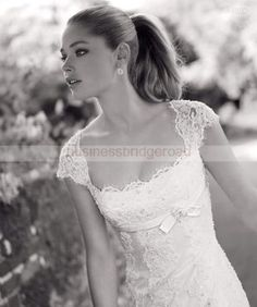 Love this lace, neckline, high waist.  Just found the dress is Provonias Nacar.