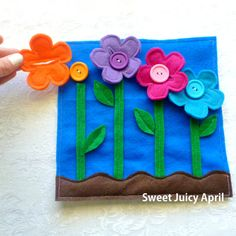 Great idea for a home-made game book or quiet book. It is made of felt .Great idea for a home-made game book or quiet book. It is made of felt and has these incredibly cute Diy Quiet Books, Baby Quiet Book, Felt Quiet Books, Sensory Book, Quiet Book Patterns, Fidget Quilt, Busy Book, Button Flowers, Book Pages