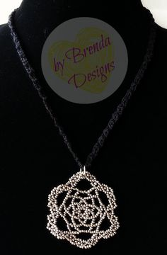 Light and comfortable crocheted necklace with a beaded statement pendant. Can be…