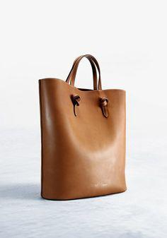 "Céline ""Twisted"" tote in tan natural calfskin. $3,250, bergdorfgoodman.com."