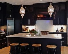 This beatiful black wide rail shaker job was designed by Edward Bader and George Kelly. There are multiple unique features in this kitchen including raised counter tops, blind corner roll out pantry, and television in the hood. Kitchen Dining, Kitchen Decor, Kitchen Cabinets, Kitchen Ideas, Dining Room, Ikea Kitchen Design, Modern Kitchen Design, Dark Grey Kitchen, Beach Look