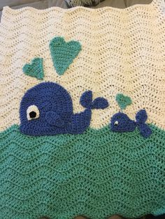 So cute! Perfect for those who love the ocean and whales... Hand-crocheted ripple design in extra soft yarns. Big blue whale and little blue whale... aqua hearts. Great shower gift! Ready to ship! Little Whale Toy included. Blanket is crib sized approximately 24 x 28. Mailed in a gift bag. This blanket is also available with Pink Whales. Email with any questions. :-)